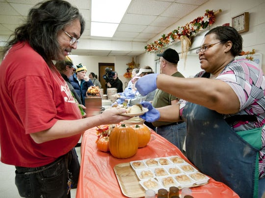 LaTrina Autry, right, a volunteer with The Salvation Army, helps serve a free Thanksgiving meal at The Salvation Army of Brown County's Corps Community Center in Green Bay in 2012. The Salvation Army will serve Thanksgiving meals at its Corps Community Center at 626 Union Court on Green Bay's west side from 11:30 a.m.-12:30 p.m. Wednesday.
