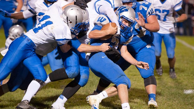 Wyford's, Zach Hoffman, pushes against the defense.