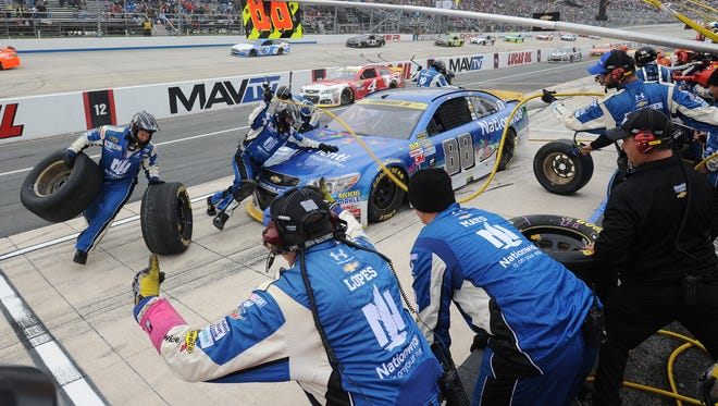Jimmy Johnson pits during the Sprint Cup Series AAA 400 Oct. 4 at Dover International Speedway.