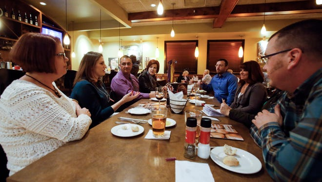 Members of a group of DINKS (couples with dual income and no kids), including, from left, Faith Shure of New Castle, Emily Heisig of Middletown, Will and Sandy Camacho of Newark, Mike and Sharon Schwartzburt of Newark and John Shure of New Castle meet at Bertucci's in the Christiana Town Center.