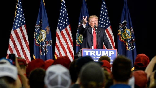 Republican presidential candidate Donald Trump speaks at his campaign rally at the Pennsylvania Farm Show Complex in Harrisburg on April 21, 2016.