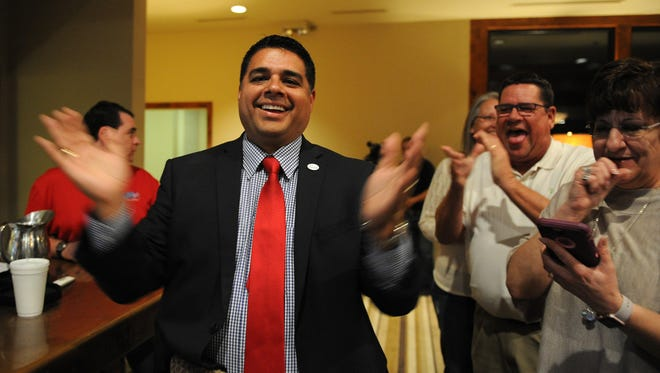 Stephan Santellana claps after the early voting results for the mayor race have come in at Santellana's election night watch party Tuesday, Nov. 8, 2016, at the Wichita Falls Country Club.