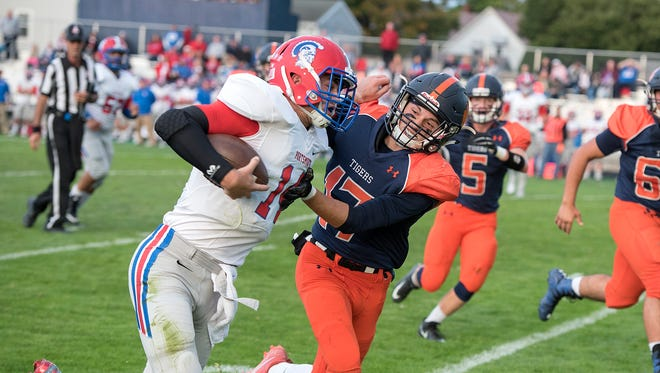 Galion's Takoda Crisman tussles with a Portsmouth player Friday night.