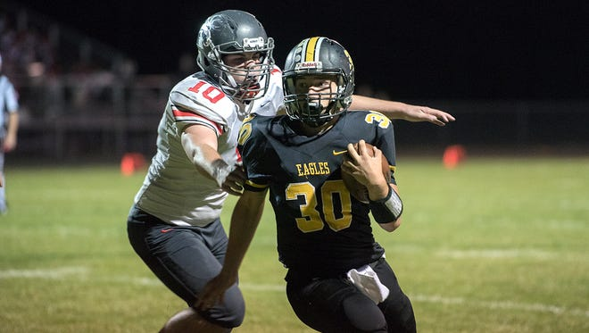 Colonel Crawford's Trevor Shawber avoids a tackle from Buckeye Central's Kyle Sanderson.