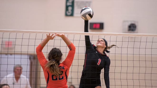 Crestview's Natalie Restille spikes the ball.