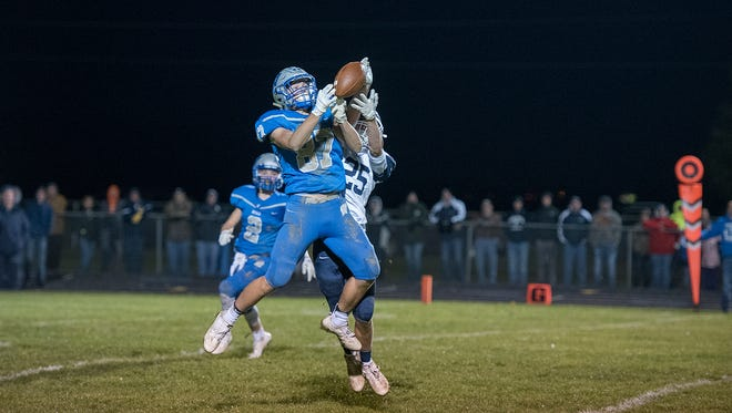 Wynford's Cole Heinlen attempts to intercept a pass intended for Carey's Griffin Summit.