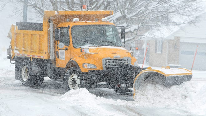 A Springettsbury Township snow plow clears snow from the intersection of Kingston and Edgewood Road, Wednesday, March 21, 2018. John A. Pavoncello photo