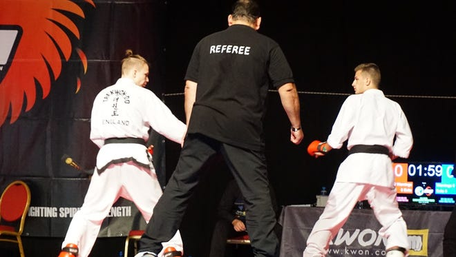 Hunter Carney, right, a junior at Stewarts Creek High, captured a title at the World Karate Union at Ireland in August.