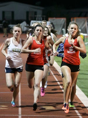 Girls run the 800 during Friday's track meet in Melbourne.