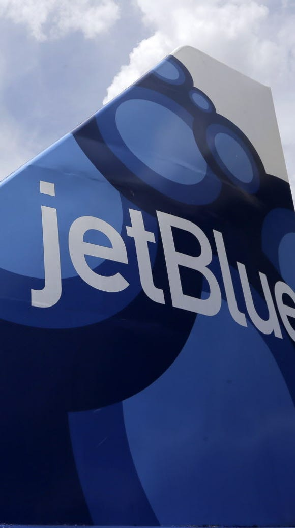 A mock tail of a JetBlue Airways plane on display June