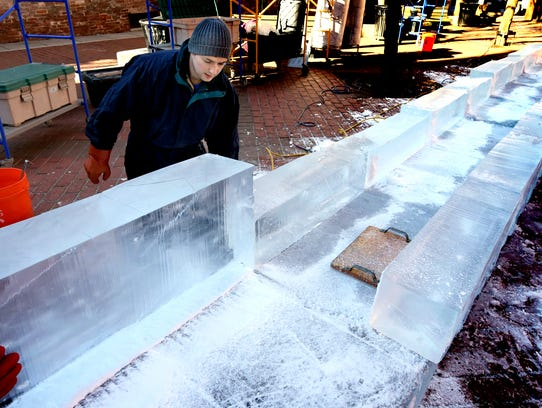 Joe DiMartino helps construct an ice slide in Cherry