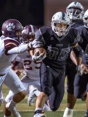 Knights running back Cameron Salas gets into the Gadsden