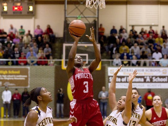 DENNY SIMMONS / COURIER & PRESS Princeton's Jackie Young (3) shoots for two points between Central defenders Zion Sanders (left) and Mykiah Jones during their game at Central High School in December.