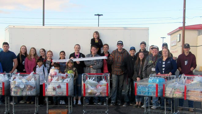 Members of the Luna County 4-H Council and parent volunteers shopped at Peppers Supermarket to help supplement the Healing House, Luna County's shelter for survivors of domestic violence.