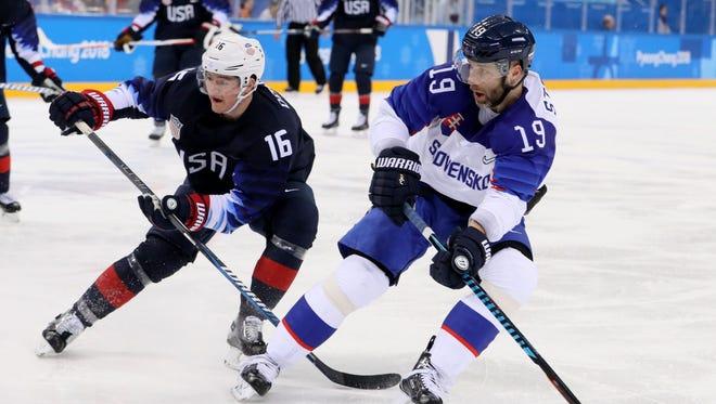 Forward Ryan Donato, who scored twice for the USA, and Slovakia defenseman Tomas Starosta.