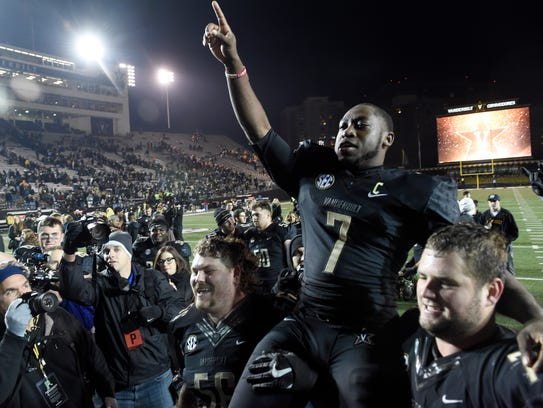 Vanderbilt running back Ralph Webb (7) is carried off