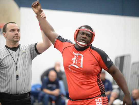 Delsea's Phillip Green reacts after pinning St. Augustine's