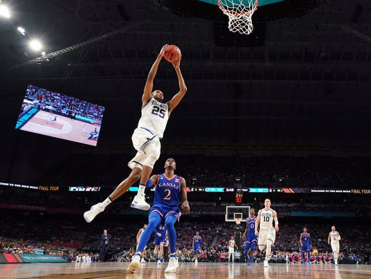 Villanova's Mikal Bridges (25) goes up for a shot against Kansas's Lagerald Vick (2) during the second half in the semifinals of the Final Four NCAA college basketball tournament, Saturday, March 31, 2018, in San Antonio. (AP Photo/Chris Steppig, NCAA Photos Pool)