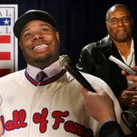 Newly-elected Baseball Hall of Fame member Ken Griffey Jr. conducts interviews with his father, Hall of Famer Ken Griffey Sr. listening in after a press conference announcing that he and Mike Piazza  were elected to baseball's Hall of Fame, Thursday, Jan. 7, 2016, in New York.