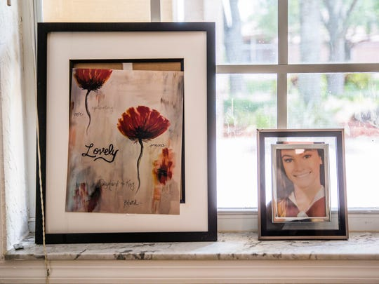 A framed photo of Meadow Pollack and a small piece