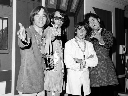 The Monkees pose on July 6, 1967, at a news conference at the Warwick Hotel in New York. The group members are Peter Tork (from left), Michael Nesmith, Davy Jones and Micky Dolenz.