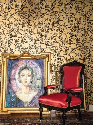 Bunny Wall, a tromp l'oeil wallpaper that recreates the walls of Slonem's studio, where his paintings hang salon-style, framed in authentic 19th century portrait frames which are hand selected by Slonem.