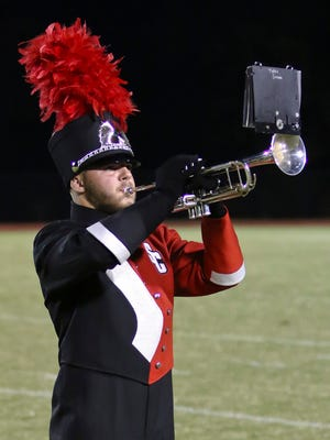 Sayler Clayton, a senior  in the Stewarts Creek band, plays taps in honor of fallen Blue Angel Jeff Kuss.