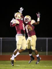 Riverdale's Isaiah Stewart (left) and Marqwell Odom celebrate Odom's touchdown run Friday.