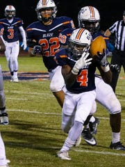 Blackman's Jeremiah Wade corrals a blocked punt to set up a TD Friday against Warren County.