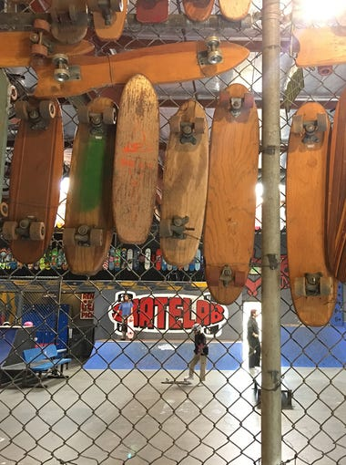 The entrance to Skatelab Indoor Skatepark in Simi Valley is lined with skateboards dating back to the 1960s. The hallway is just part of the Skatelab Museum.