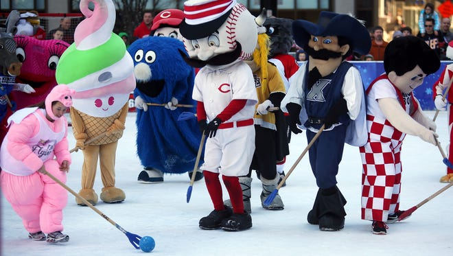 Local mascots warm up before the annual Mascot Broomball game on Fountain Square in 2015.