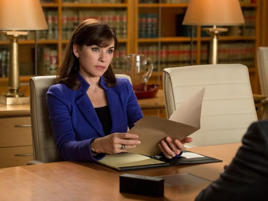 "This image released by CBS shows Julianna Margulies as Alicia Florrick in a scene from ""The Good Wife."" Margulies was nominated for a Golden Globe for best actress in a drama series for her role in the series on Thursday, Dec. 12, 2013.  The 71st annual Golden Globes will air on Sunday, Jan. 12. (AP Photo/CBS, David Giesbrecht)"
