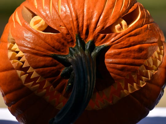 A pumpkin carved by chef John Hale sits outside Eagle Ridge Conference Center in Raymond Friday, Oct. 13, 2017.
