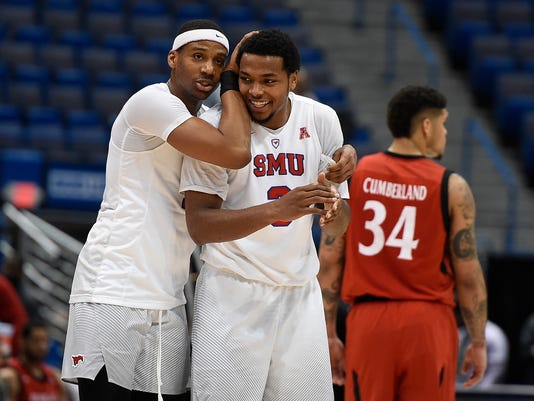 SMU's Jarrey Foster and Sterling Brown celebrate at the end of an NCAA college basketball game against Cincinnati in the American Athletic Conference tournament finals, Sunday, March 12, 2017, in Hartford, Conn. (AP Photo/Jessica Hill)