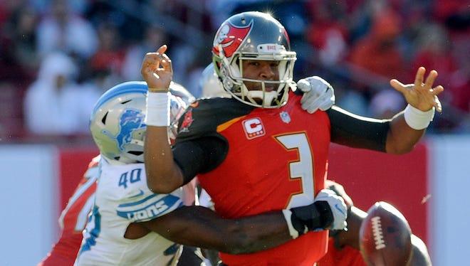Buccaneers quarterback Jameis Winston fumbles when he is hit by Lions linebacker Jarrad Davis.