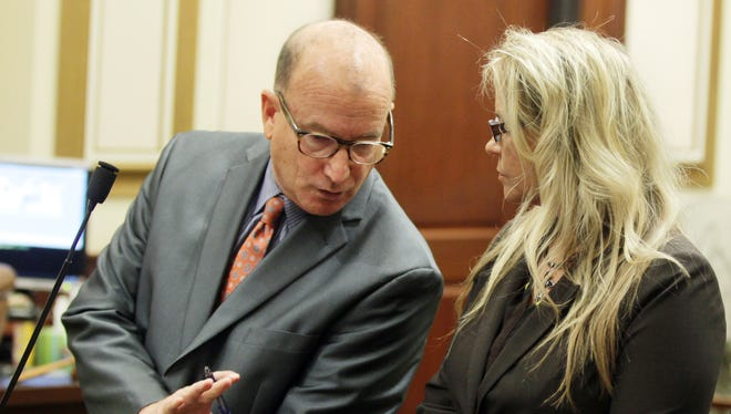 """Defense attorney Mike Allen cautions Lisa Hamm not to ask questions of attorneys while Judge John 'Skip"""" West is passing sentence on her.  She received five years probation for three counts of unauthorized use of property.  She must also serve 120 days in a women's program at Talbert House."""