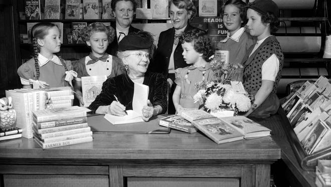 Laura Ingalls Wilder signs books at the Brown Brothers Book Store in Springfield in this photo from November 1952. Ingalls WIlder was the author of the Little House on the Prairie books, which spawned the eponymous hit television series of the late 1970s.