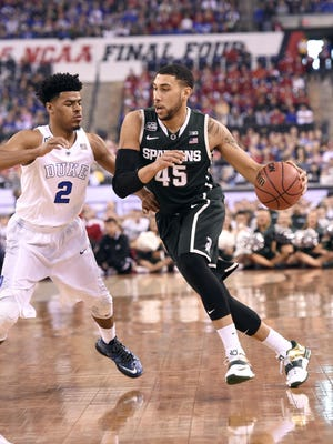 MSU's Denzel Valentine drives the ball towards the basket agsinst Duke's Quinn Cook in the Final Four in Indianapolis Friday 4/3/2015.