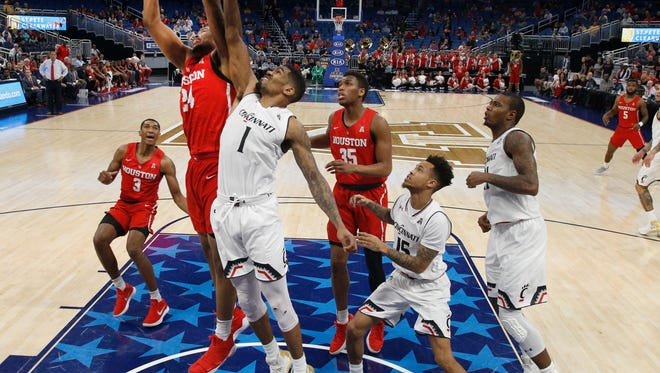 Houston Cougars forward Breaon Brady (24) and Cincinnati Bearcats guard Jacob Evans (1) fight for the rebound under the net during the first half of the championship game at Amway Center.