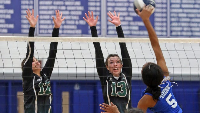 Yorktown's Kristen Papitto (12) and Kayla Knoesel (13) blocks Hendrick Hudson's Neigha Ramsay (5) shot during Section 1 Class A girls volleyball quarterfinal at Hendrick Hudson High School in Montrose Nov. 1, 2016.