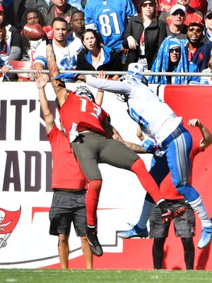 The Buccaneers' Mike Evans can't pull in a one-handed reception in the end zone with the Lions' Teez Tabor defending in the first quarter.