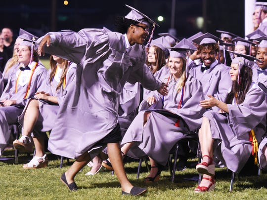 Sumer Williams dances as she walks to get her diploma