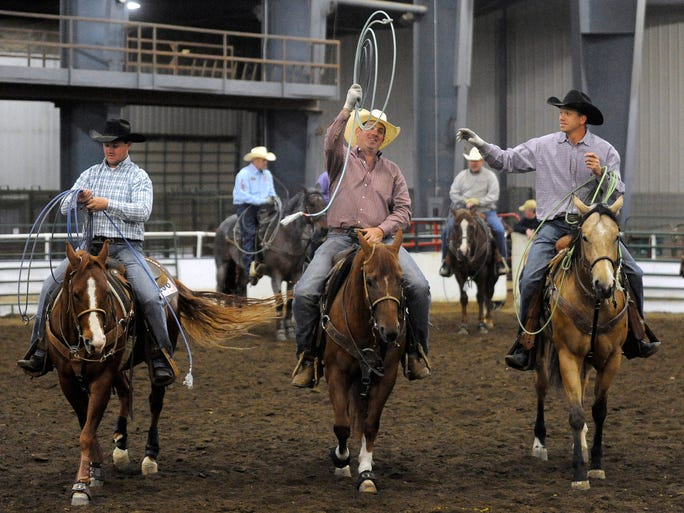 Chris Anderson, Jordan Allyn and Jamie Stover get ready for the heeling event during the Sioux Empire Quarter Horse Show at W.H. Lyon Fairgrounds in Sioux Falls, S.D. Friday, May 9, 2014.