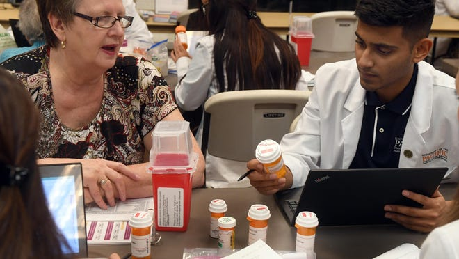 Sheel Patel, a student at University of the Pacific's Thomas J. Long School Pharmacy,  talks with Sharon King, left, during a visit at a Medicare Fair on Nov. 2, 2017. A University of the Pacific alumna has donated millions of dollars to fund drug development at the university's Thomas J. Long School of Pharmacy in Stockton.