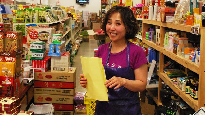 Young Heun Kim, who uses the English name Stella, runs the Green Castle Asian Market in Lansing with her husband, Harry.