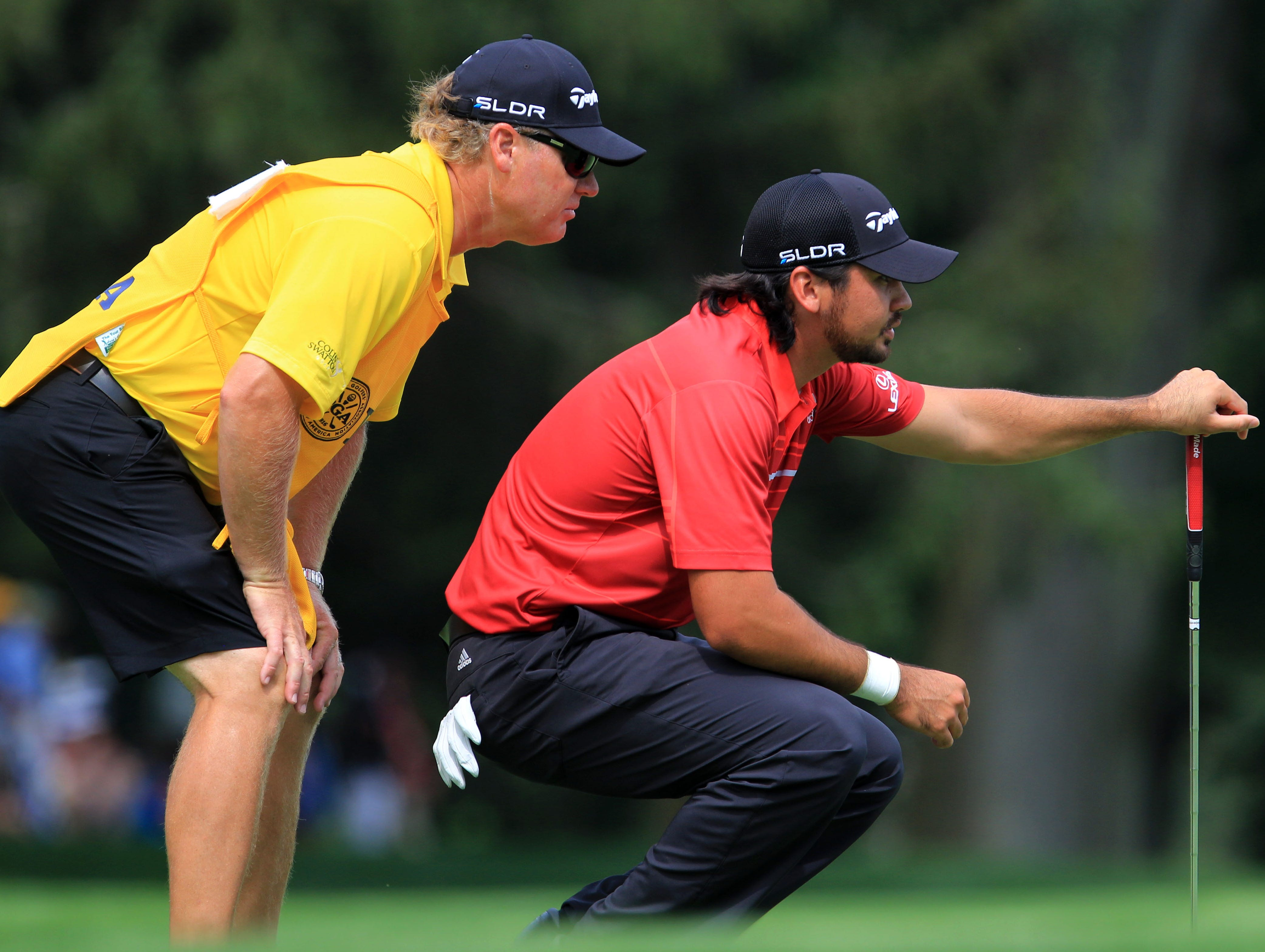 Jason Day lines up his putt on the 9th green.