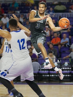 Norcross High School's Kyle Sturdivant looks to pass against IMG Academy during play Saturday at the Culligan City of Palms Classic at the Suncoast Credit Union Arena in Fort Myers. IMG beat Norcross 62-59 victory.