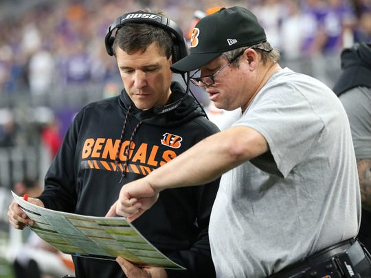 Cincinnati Bengals offensive coordinator Bill Lazor, left, and offensive line coach Paul Alexander look over a play sheet in the fourth quarter during the Week 15 NFL game between the Cincinnati Bengals and the Minnesota Vikings, Sunday, Dec. 17, 2017, at U.S. Bank Stadium in Minneapolis, Minnesota.