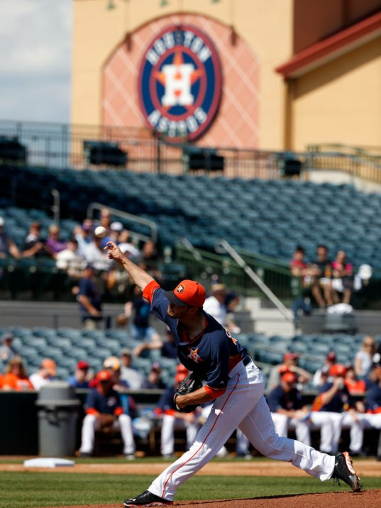 Houston Astros starting pitcher Jarred Cosart throws in the first inning of a spring exhibition baseball game against the Atlanta Brave, Sunday, March 2, 2014, in Kissimmee, Fla. (AP Photo/Alex Brandon)