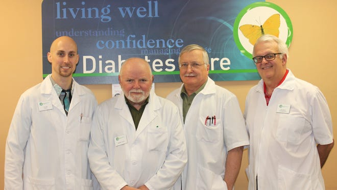 Tyler Wallenfang, left, bought the Consumer Prescription Center in Appleton. It is now the Appleton Hometown Pharmacy. The staff of pharmacists stayed on, and include his father, Jerry Wallenfang, Jerry Wallenfang; former Consumer Prescription Center owner Warren Doering and George Gosz.